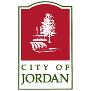 Red logo with a white tree and river, City of Jordan