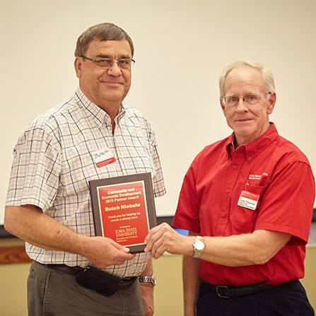 Butch Niebuhr receiving an award