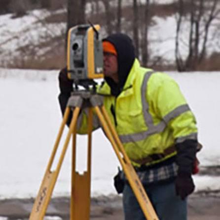 Man surveying in winter