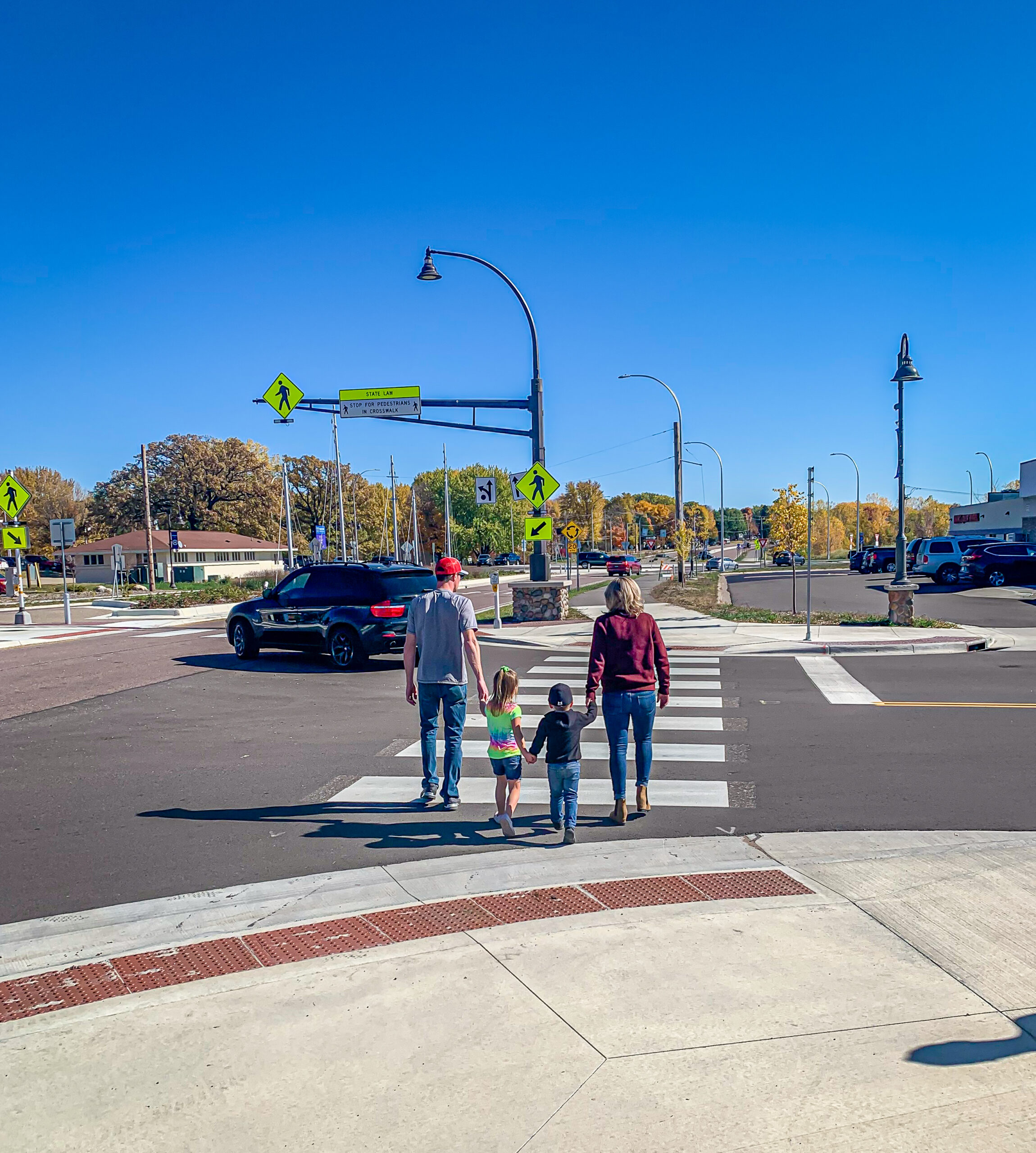 Family walking in crosswalk